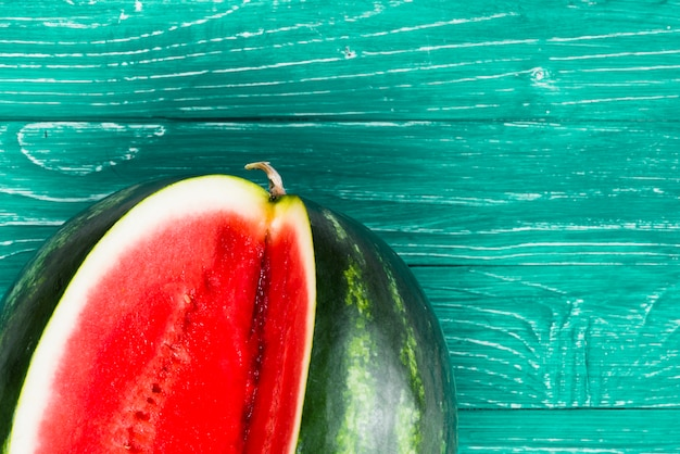 Sweet watermelon cut on green background