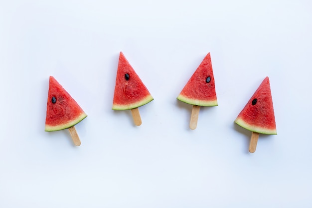 Sweet watermelon slice popsicles on white background