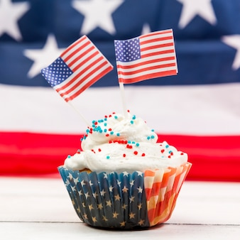 Sweet whipped cream cupcake with american flags
