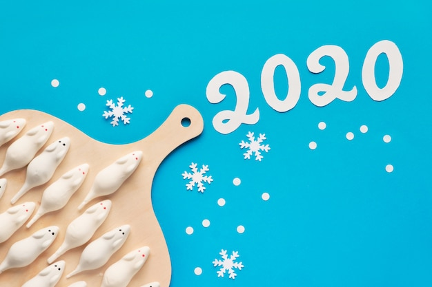 Sweet white mice with number 2020 on pastel paper, new year background