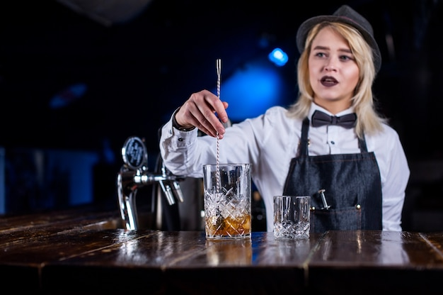 Sweet woman barkeeper surprises with its skill bar visitors in the nightclub