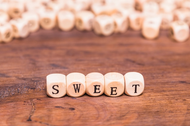 Sweet word made with wooden dices