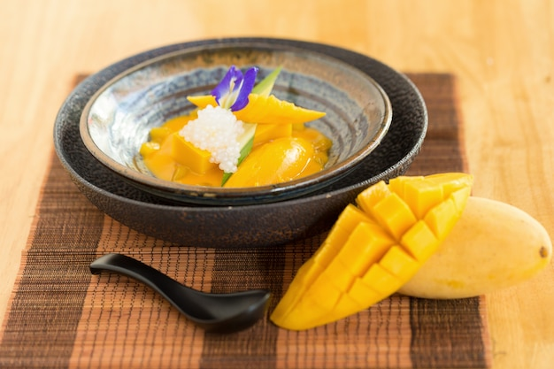 Sweet yellow mango pudding on wooden table