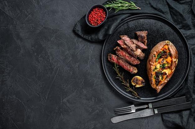 マーブルビーフステーキと焼きsweetの付け合わせ。グリルされた肉