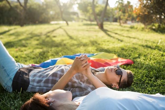 Sweethearts women lying on nature