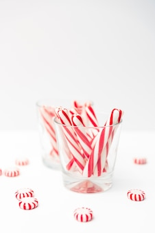 Sweetmeat on table and sticks candies in glass