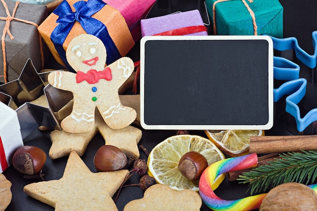 Sweets and biscuits for christmas and a blackboard