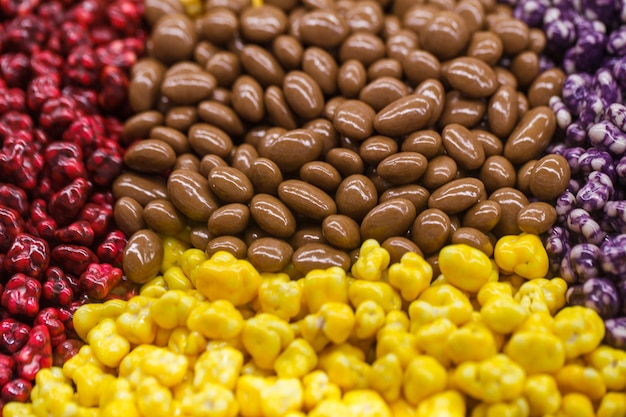 Sweets in bulk, chocolate and in a multi-colored glaze