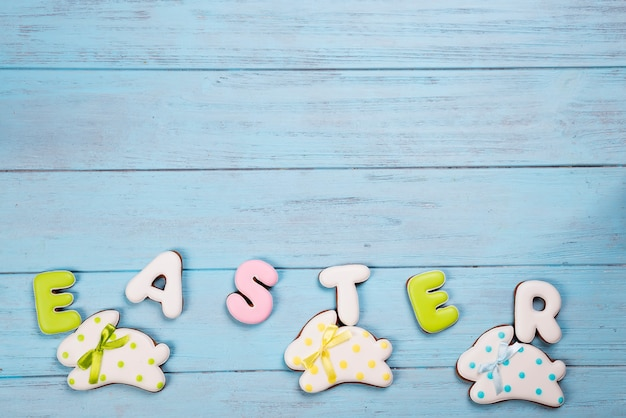 Sweets for celebrate easter. gingerbread in shape of easter bunny and letter easter.
