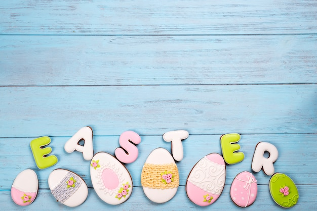 Sweets for celebrate easter. gingerbread in shape of easter eggs and letter easter.