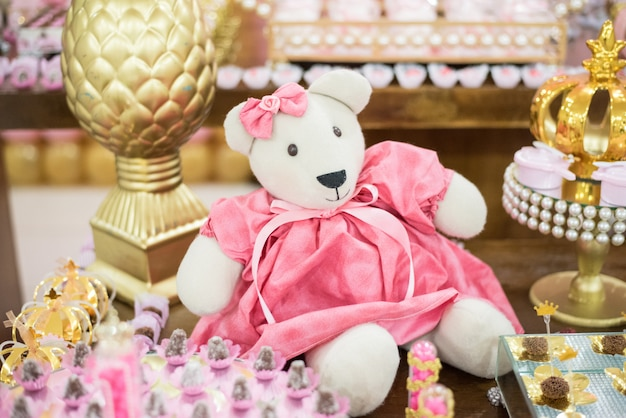 Sweets and decoration on the table - children's party bear princess theme
