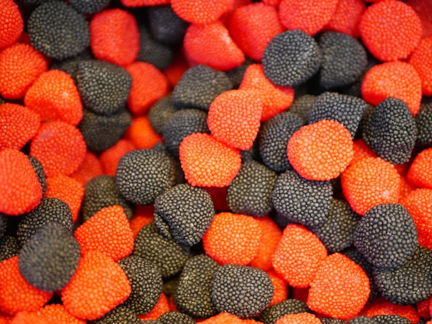 Sweets in the form of raspberries. multi-colored sweets. close-up. children's sweets. the cause of childhood caries.