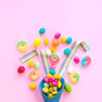 Sweets scattered on pink table