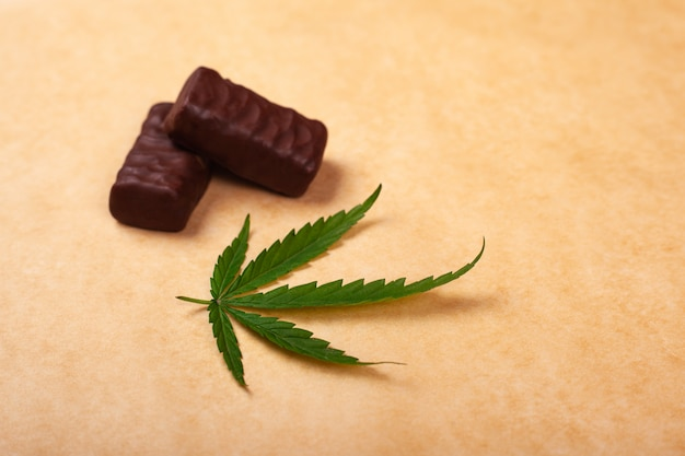 Sweets with a leaf of cannabis, chocolates with marijuana.