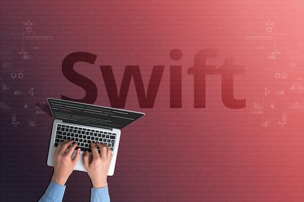 Код языка программирования swift с человеком и ноутбуком.