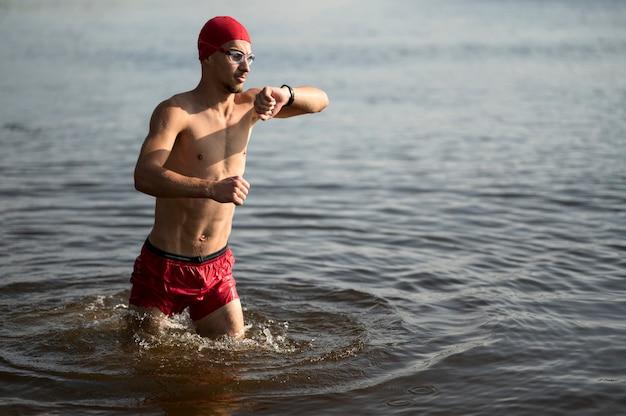 Swimmer walking in lake