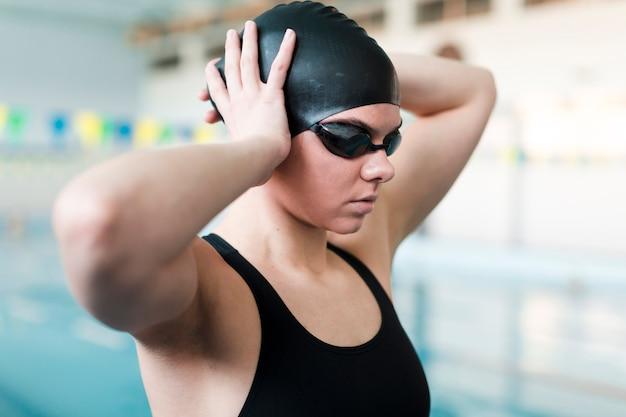 Swimmer wearing swimming cap