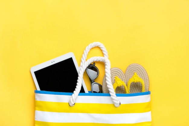 Swimming accessories on yellow table
