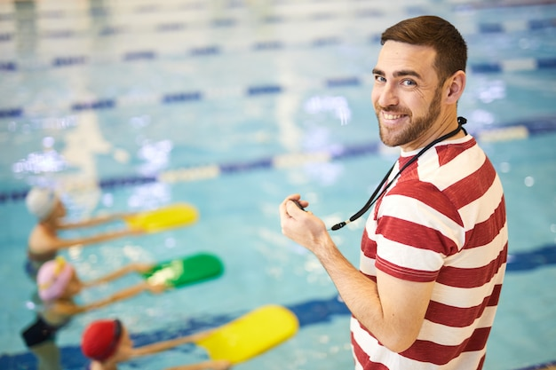 Swimming instructor with group