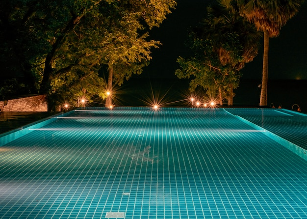 Swimming pool blue at night have light
