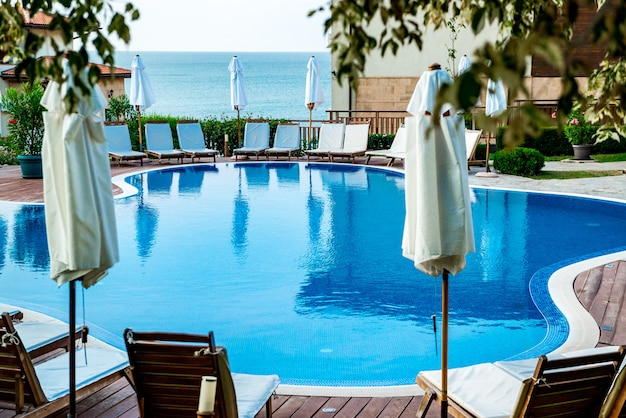 Swimming-pool by the sea, morning at sea