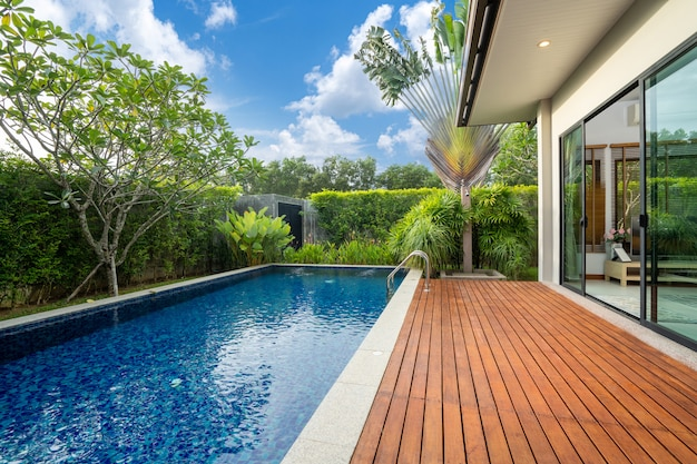 Swimming pool and decking in garden of luxury home