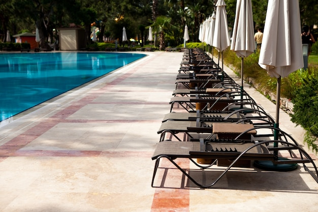 Swimming pool in the hotel summer holidays in hot tropical countries relaxation zone
