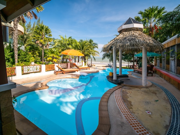 Swimming pool in luxury resort or hotel near beach, thailand