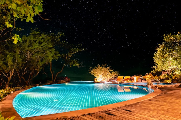 The swimming pool in the night under a starry sky