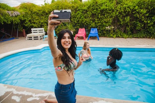 Swimming pool party selfie