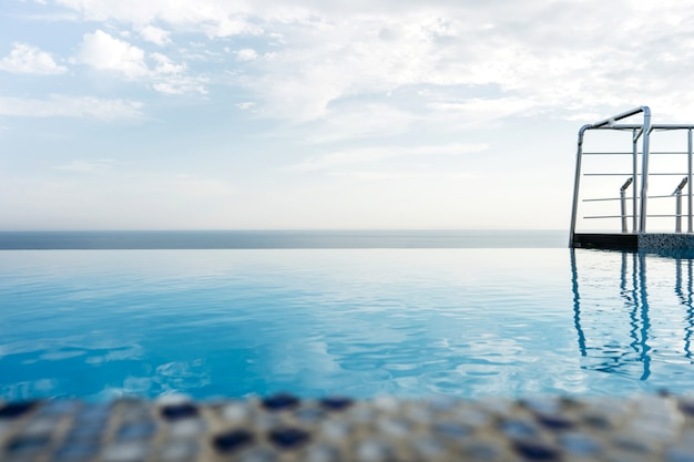Swimming pool on the roof of the house overlooking the sea