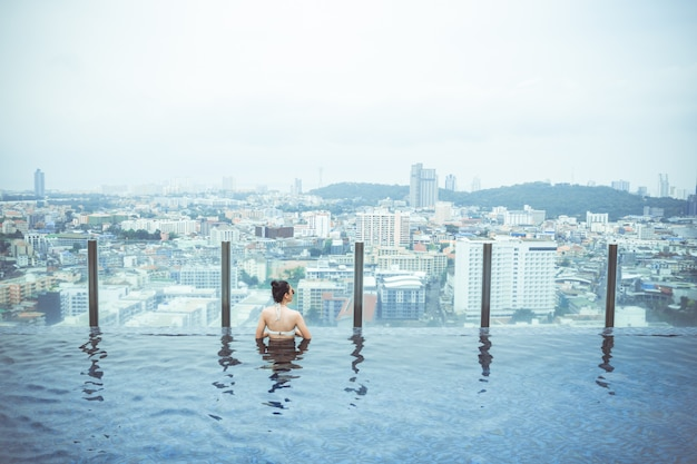 Swimming pool on roof top with beautiful city view, seascape city view, pattaya, thailand