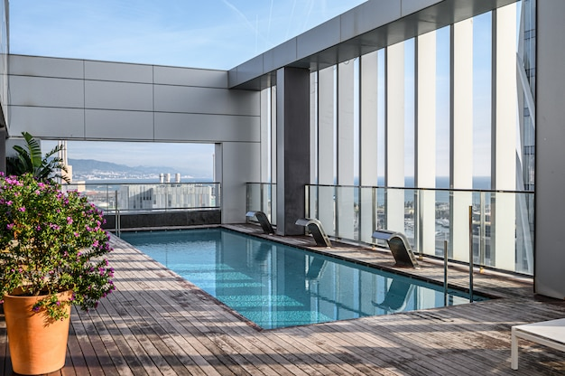 Swimming pool on roof top with beautiful city view of the skyscrapers