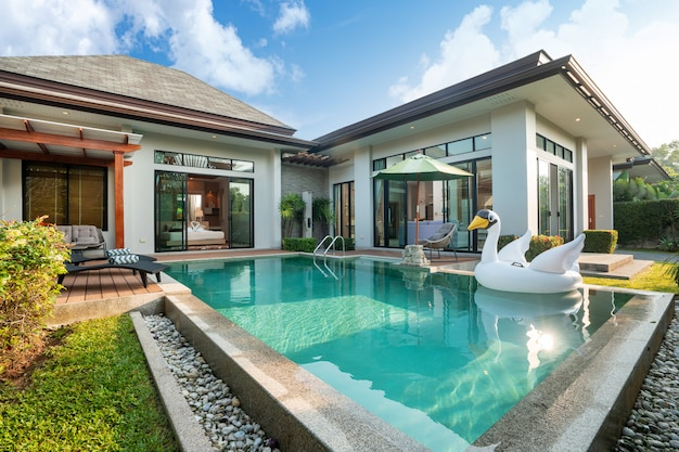 Swimming pool in tropical garden villa