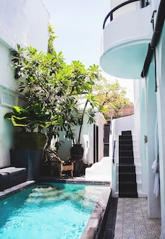 Swimming pool in the white greek design house.