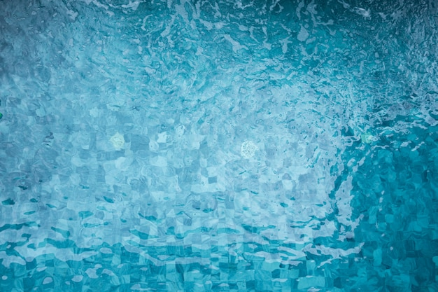 Swimming pool with water flow, copy space, summer vacation concept.