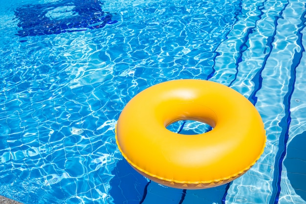 Swimming pool yellow inner tube i pool