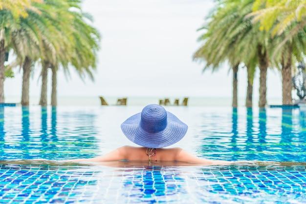 Swimming woman bikini blue tan