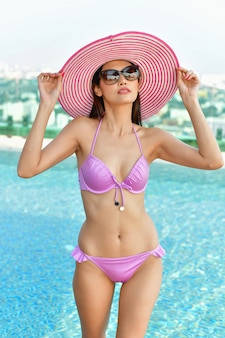 Swimsuit Concept. Beautiful girl wearing pink swimsuit.
