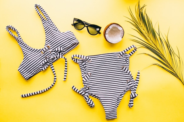 Swimsuit on yellow background isolated
