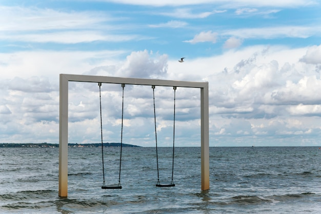 Swing on beautiful sea shore and beach, sweden, helsingborg