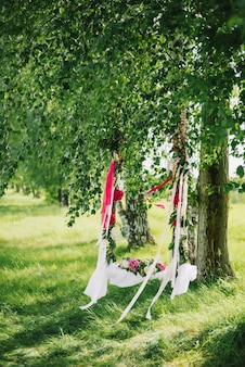 Swing decorated with flowers for romance couple in love in the summer