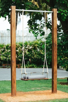 Swing in the garden and green grass.