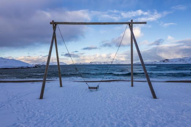 Swings on the coast of the arctic ocean, teriberka, russia