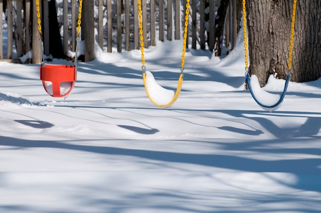 Swings at playground covered in snow
