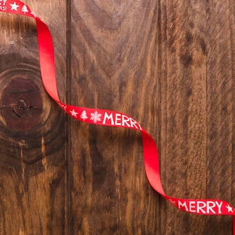 Swirling christmas ribbon on wooden table