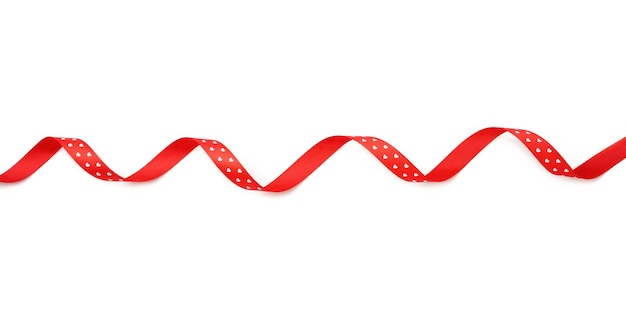 Swirling red silk ribbon on white background, gift wrapping decor