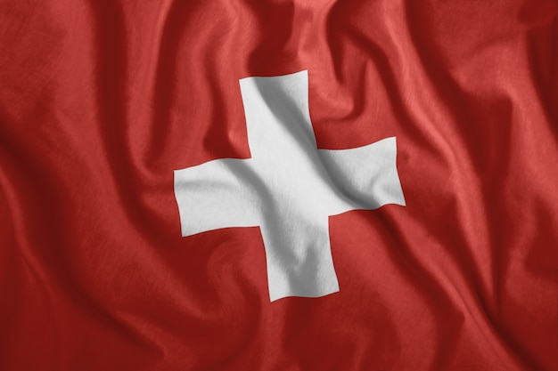 The swiss flag flutters in the wind