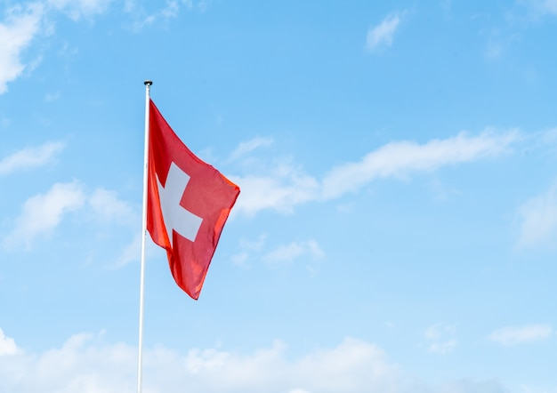 Swiss flag with sky