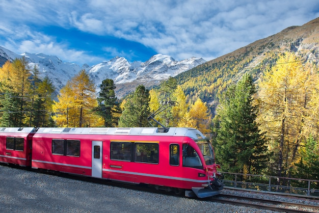 Swiss mountain train bernina express crossed alps in autumn